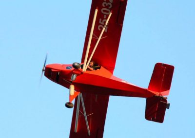 Australian LightWing GR 912 Red aircraft in flight straight up. Tail wheel